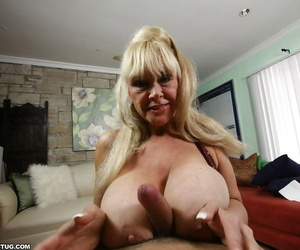 Lusty granny prevalent Brobdingnagian knockers sucks a cock together with gives a titjob