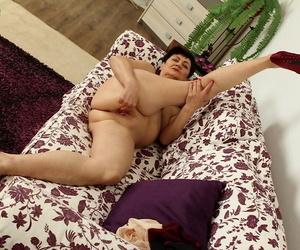 Older woman Karoline fondling enveloping natural tits via vilification