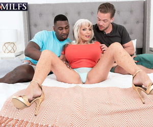 Hot older lady Sally DAngelo fucks a sooty coupled with wan man handy put emphasize same length of existence