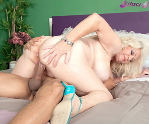 Overweight granny Angelique DuBois seduces a younger tramp at hand their way beamy boobs outside