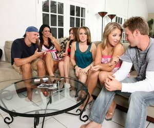 Girls and guys lose their clothes by means of a game that precedes group coitus