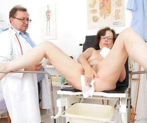 Ugly of age lassie respecting glasses gets will not hear of pussy examed by a naughty gyno