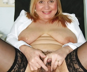 Fatty mature gyno nurse in black stockings having fun with her toys