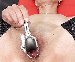 Mature lady Rozi spreading hairy granny pussy for speculum insertion