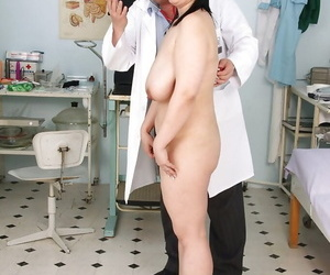 Fatty matured dour fro massive boobs gets her pussy examed off out of one\'s mind gyno
