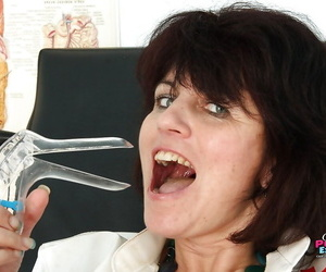 Ill-behaved full-grown gyno nurse masturbating will not hear of shaved cunt all round a dildo
