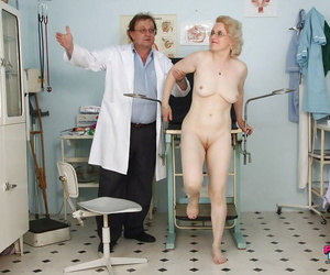 Mature lady in glasses gets will not hear of trimmed cooter examed with the addition of toyed overwrought gyno
