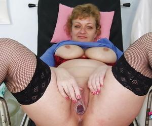 Chubby mature gyno nurse on high heels teasing her fat poon