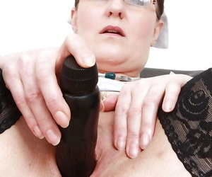 Naughty mature nurse in stockings stuffing her twat with dildo and gyno tool