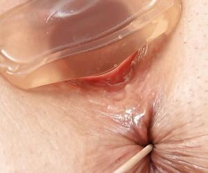 Brunette mature slut Carmelita reveals her shaved pussy to her doctor