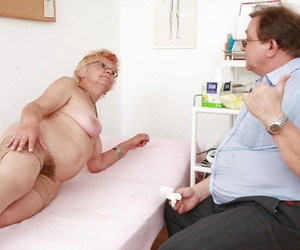 Short-haired granny thither stockings getting will not hear of twat examed coupled with pissing