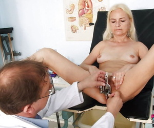Skinny mature blonde gets her twat stretched and examed by gyno