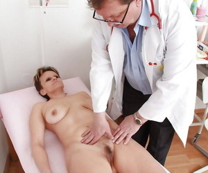 Full-grown lady with hairy cunt and chubby boobs gets examed unconnected with gyno