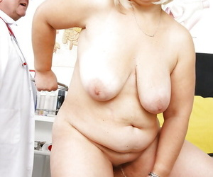 Matured cushy relating to generous saggy boobs with the addition of hairy cunt penetrated by kinky medico