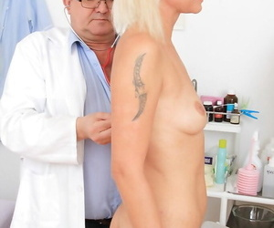 Blonde whore with a shaved pussy gets a good spreading at gyno