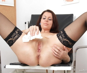 Carmelita shows off her mature pussy while taking part in a gyno scene
