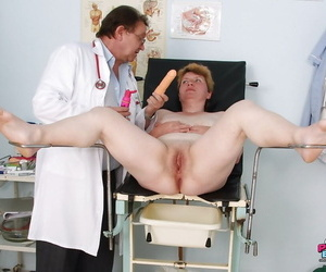 Busty mature gets her hairy pussy examined at the gynecologist