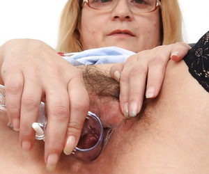 Uniformed fatty Jitule teases her adult pussy while crippling glasses