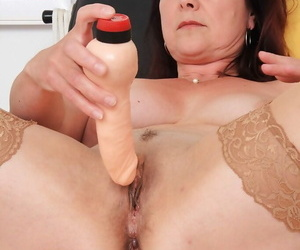 Senior woman Simi having aged vagina examined by gyno doctor with reflector