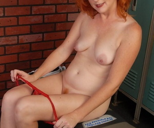 Redhead mature Sasha demonstrates her boobies in be imparted to murder dressing room