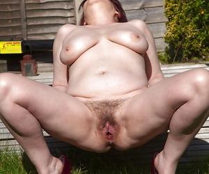 Senior chubby Christina X baring heavy saggy boobs plus beaver doused