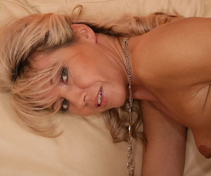 Blond mom over 50 Janet Darling flashing white panties and nice mature legs