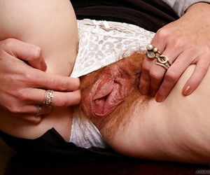 Petite redheaded wife Ana Molly pulling panties aside to spread hairy bush