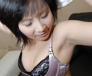 Asian indulge Minori Nagakawa stripping there and exposing say no to hairy cunt
