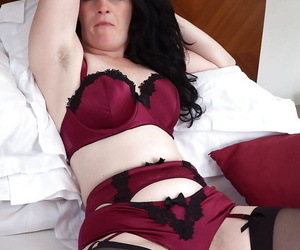 Experienced lady Andrea Summon up demonstrating hairy vagina on touching malicious nylons