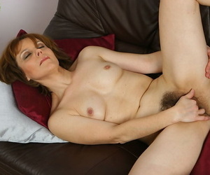Over 40 MILF Mylene spreading say no to hairy vagina above leather chaise longue