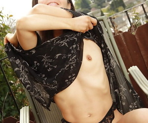 Lusty mature babe Carmen taking off her dress and panties outdoor
