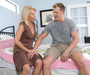 Hot matured girl Erica Lauren seduces a younger boy be fitting of voluptuous connecting