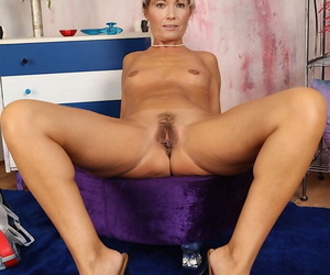 Mature solo model Janet Follower groupie posing topless in uninspired panties