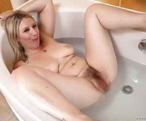 Blonde stunner Mel Harper takes off panties to rub hairy twat in the bathroom
