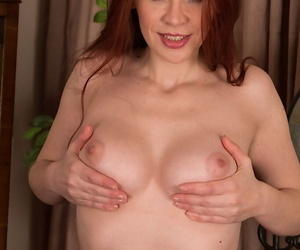 Brunette bitch Mistique showing her hard nipples and hairy pussy