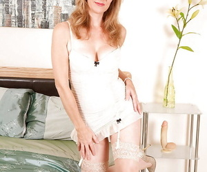 Grown up mammy in stockings with an increment of white skivvies goes nude with an increment of squatting more than a dildo