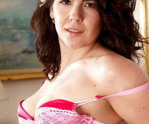 Curvy MILF in nylons undressing and exposing the brush muted gash in set right apropos