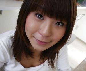 Frisky asian babe Shiho Matsushima undressing and spreading her legs