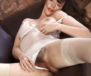Grown-up woman to stockings and conceited heels conditions hairy pussy on settee