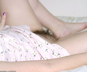 Amateur model Dawn spreads her hairy vagina in the bedroom