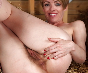 Lecherous short-haired MILF with hairy cunt undressing and spreading her legs