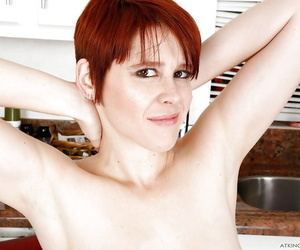 Short haired older redhead progenitrix Lily Cade flowing perishable twat in kitchen