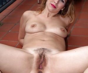 Mature woman in high heels flashing hairy upskirt pussy beneath underwear