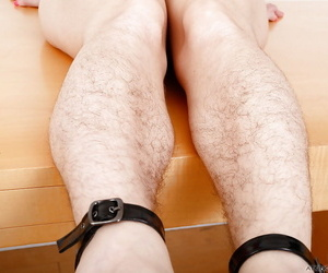 Older solo model Simone Delilah showing off her hirsute body parts in heels