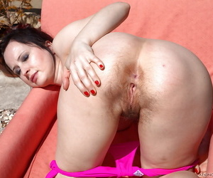Middle aged brunette Nikita resembling off their way hairy pussy in personal space horse-racing throne