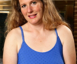 Middle-aged woman with furry armpits unveils her hairy snatch