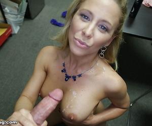 Busty mature pornstar Cheri DeVille giving big penis handjob at work