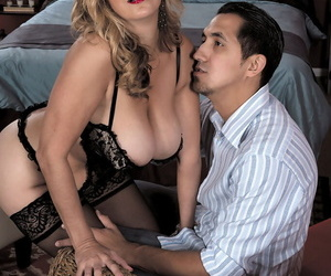 Middle-aged blonde woman Sophia Jewel seduces a younger guy in black lingerie