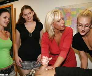 Mature slut teaching her teenage students how to give a proper handjob
