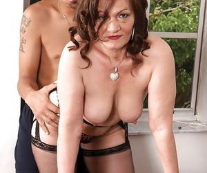 Heated bbw mom in gartered stockings Dacia Logan stripped down and mouth fucked